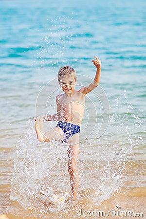 Happy boy in the sea