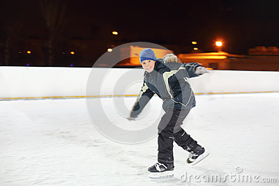 Happy boy skates with arms outstretched