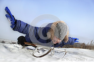 Happy Boy On Sled Royalty Free Stock Image - Image: 26661936