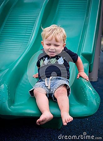 Happy boy on slide