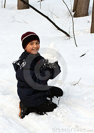 Happy boy with snowball