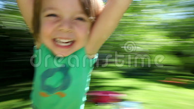 Happy boy spinning. Little boy spinning around and around laughing and smiling at the end of his fathers arms on a sunny day