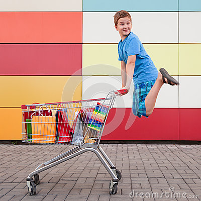 Boy  with shopping trolley