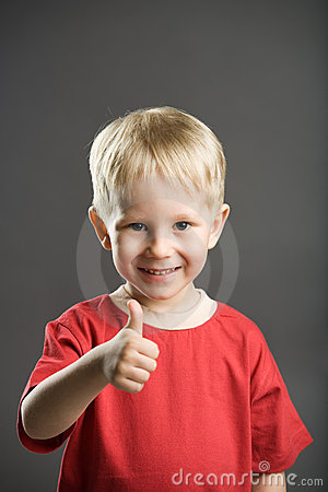 Happy boy with thumb up