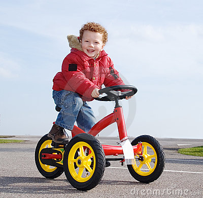 Happy boy on trike, bike