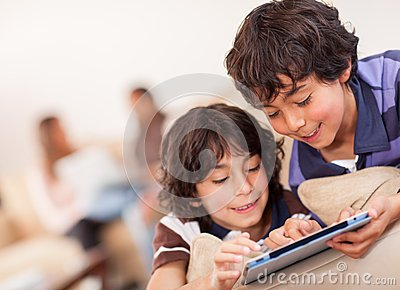 Happy boys with a tablet