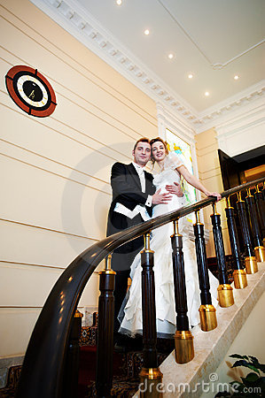Free Happy Bride And Groom At Luxurious Stairs Royalty Free Stock Image - 18266816