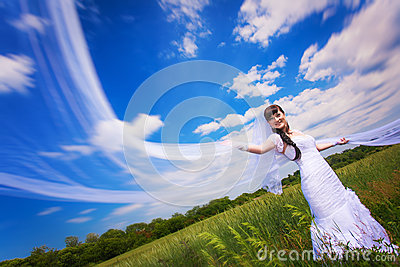 Happy bride on the blue sky background