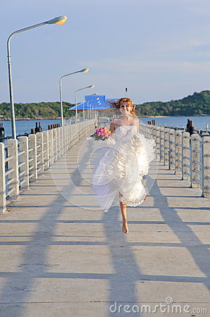 Happy bride on the bridge