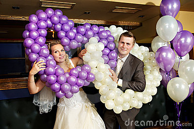 Happy bride and groom with air balloons