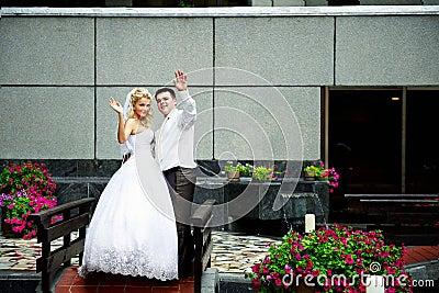 Happy bride and groom in beautiful interiors