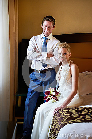 Happy bride and groom in bedroom