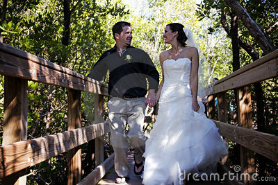 Happy Bride and Groom on boardwalk