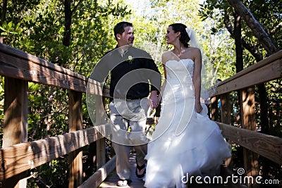Happy Bride and Groom on boardwalk
