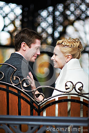 Happy bride and groom on decorative bench