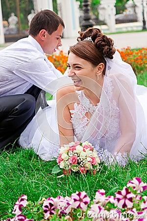 Happy bride and groom having fun