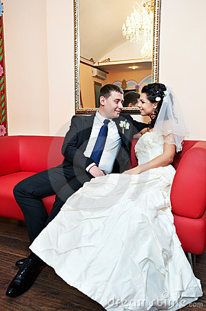 Happy bride and groom in luxury palace