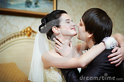 Happy bride and groom passionate embrace