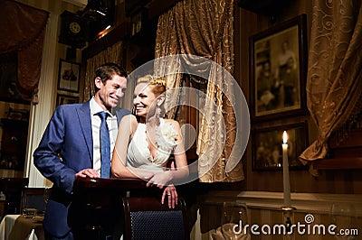 Happy bride and groom in vintage interior