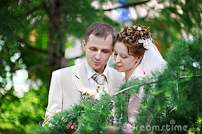 Happy bride and groom at wedding walk