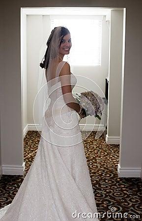 Happy bride in hallway
