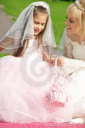 Happy bride and little bridesm