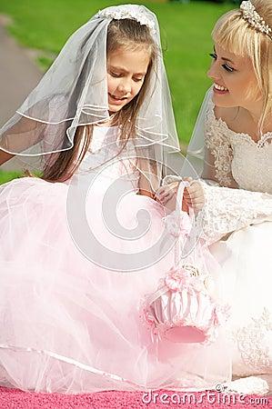 Happy bride and little bridesm