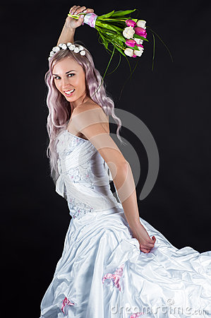 Free Happy Bride Running With A Bouquet Of Tulips Royalty Free Stock Photos - 52555208