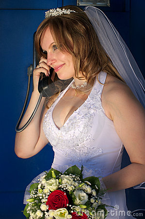 Happy bride talking phone