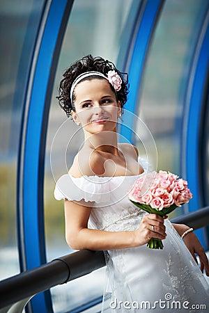 Happy bride with a wedding bouquet