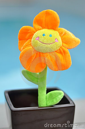 Happy Bright Orange Toy Flower in Plant Pot