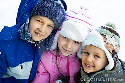 Happy Brothers And Sisters On Snow