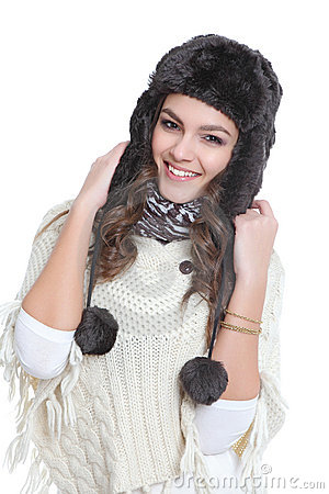 Happy brunette with fur hat