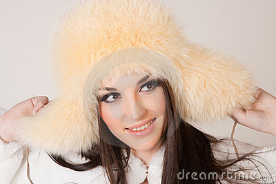 Happy brunette girl with furry hat