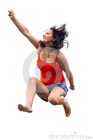 Happy brunette jumping over white