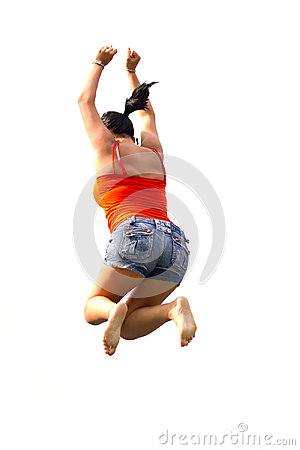 Happy brunette jumping over white background