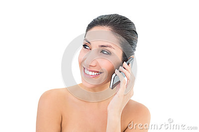 Happy brunette making a call on smartphone
