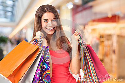 Happy brunette with shopping bags