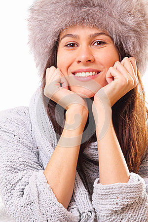Happy brunette woman in a fur hat