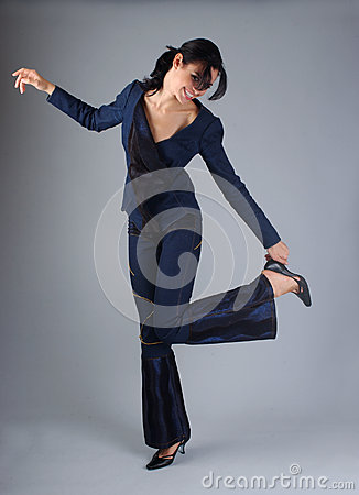 Happy brunette woman posing in the studio