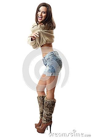 Happy brunette woman wearing braces, posing on whi