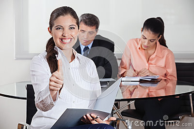 Happy busines woman with files