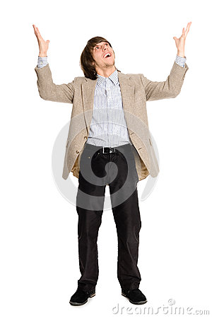 Happy business man with arms raised