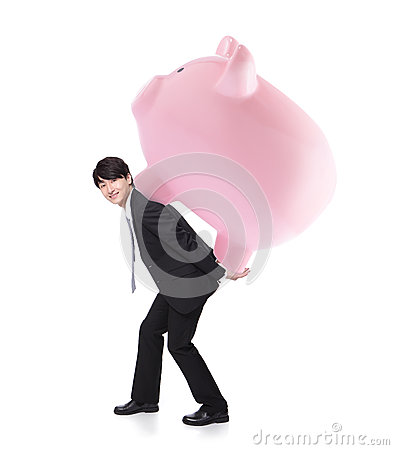 Happy business man carrying pink piggy bank