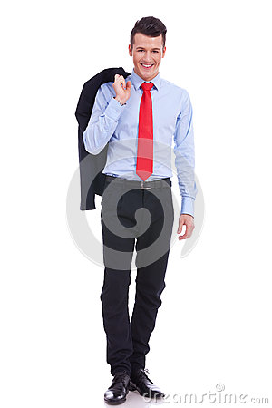 Happy business man with coat over shoulder