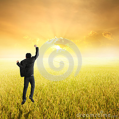 Free Happy Business Man Jumping In Yellow Rice Field And Sunset On Success Royalty Free Stock Photo - 57892085