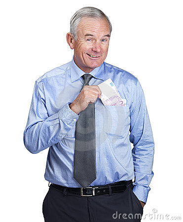Happy business man putting cash into pocket