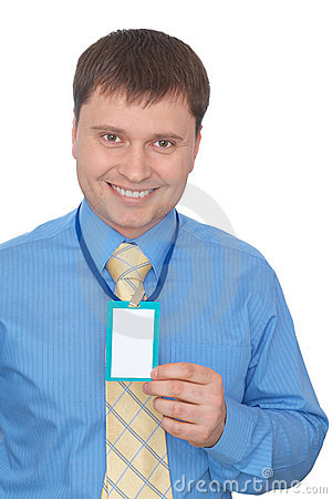 Happy business man showing his badge