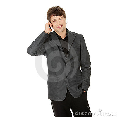 Happy business man using mobile phone