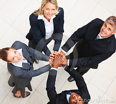 Happy business people with their hands togeher